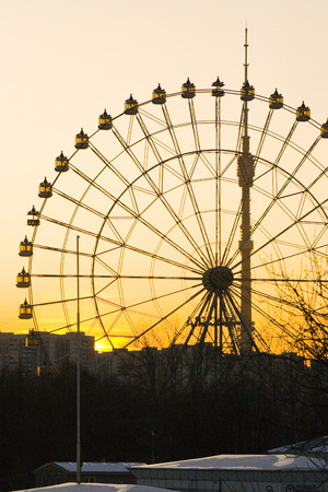 Ferris wheel at VDNH in Moscow against the starry sky at sunset