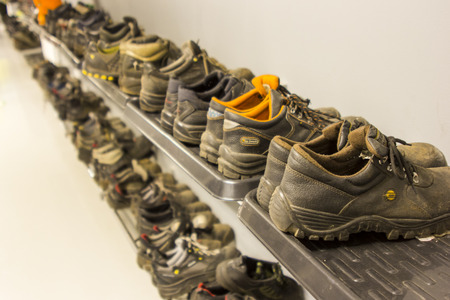 shoe store: Shoes and sneakers on a shelf in a row Stock Photo