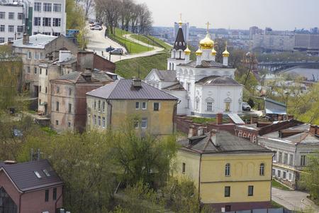 oka: Church of Nizhny Novgorod among houses in cloudy weather Stock Photo