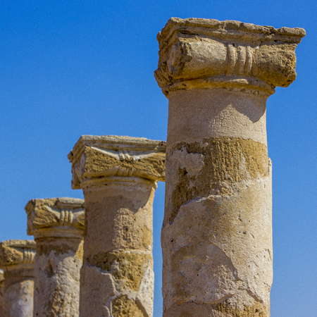 stone ancient Greek columns discovered during excavations of the ancient Greek city of Cyprus in Paphos