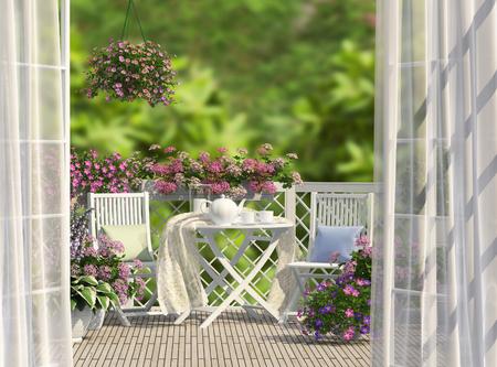 Balcon, mobilier blanc et fleurs Banque d'images