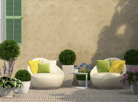 Cozy terrace in the garden with flowers Stockfoto