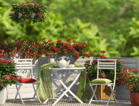White furniture and red flowers оn the balcony Imagens