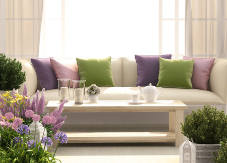 Beautiful terrace with sofa, flowers and candles