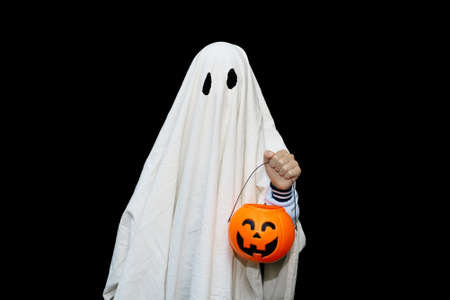 Halloween ghost costume with basket of pumpkin. Isolated on black background.