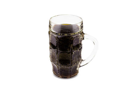 Glass mug of beer, kvass or other dark carbonated drink without foam. Isolated on white background.