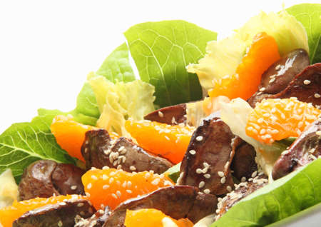 giblets: Warm salad with chicken liver, lettuce, tangerine and sesame seeds