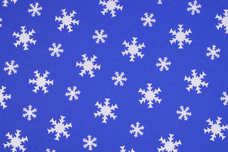 White snowflake confetti on blue background.