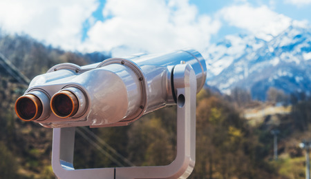 touristic telescope look at the city with view snow mountains, closeup binocular on background viewpoint observe vision, metal coin operated in panorama observation, travel nature concept Banque d'images