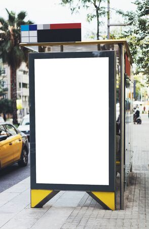 Blank advertising light box on bus stop, mockup of empty ad billboard on night bus station, template banner on background city street for message or text in Barcelona, afisha board and headlights of taxi cars