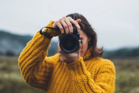 photographer girl take photo on camera closeup on background autumn foggy mountain, tourist shooting nature mist landscape, hobby concept, copy space Banque d'images - 132560173