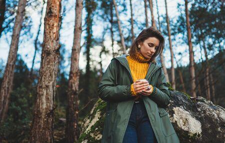tourist traveler think relax green forest landscape blue sky,  hipster woman hold hot tea rest nature trip, hiking leisure Stok Fotoğraf