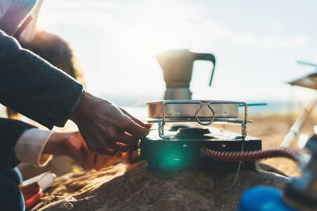 moka pot coffee outdoor, campsite morning picnic lifestyle, person cooking hot drink and food in nature camping, cooker prepare breakfast