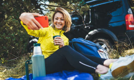 Isolation woman take fun selfie on smartphone on nature, Girl smile showing teeth video calling on mobile phone summer outdoors. Joy tourist  with cellphone while traveling auto