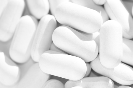 care about the health: white tablets Stock Photo