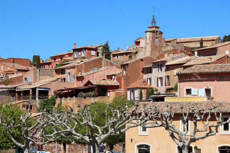 pictorial: Old pictorial village in La Provence, wooden windows with plants, red houses because of ochre, beautiful view, summer outdoors