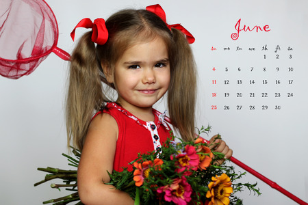 June 2017 calendar with cute little girl in a red dress with beautiful summer bunch of flowers and butterfly net