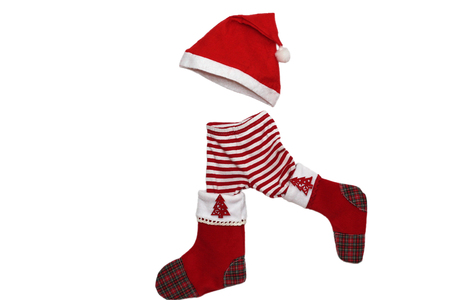 attributes: Christmas clothes and attributes forming a little walking child on white background, winter holiday symbol