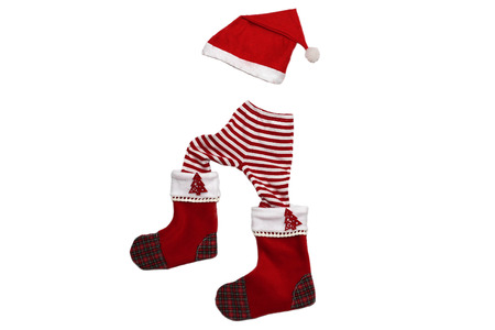 attributes: Christmas clothes and attributes forming a little walking upward child on white background, winter holiday symbol