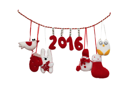 features: New Year 2016 sign formed with handmade Christmas toys over white background, winter holidays symbol