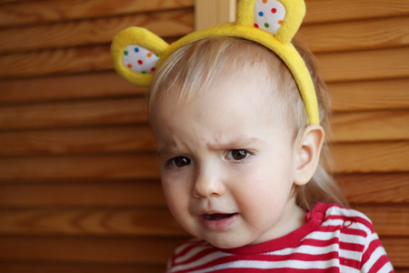 cynical: Close-up portrait of skeptical toddler boy looking suspicious with disgust on face, negative human emotions Stock Photo