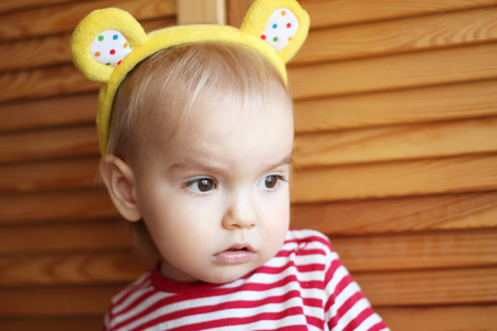cynical: Close-up portrait of skeptical toddler boy looking pensively with doubt on face, human emotions