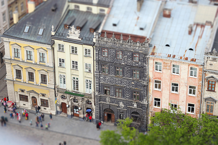 Beautiful landscape of the central part of Ukrainian Lviv city, old houses and sculptures, horizontal summer outdoor, tilt shift lens effect image, selective focus, top view, famous place, Ukraine