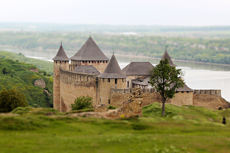Medieval Khotyn Fortress, Ukraine, historical fortification monument on the bank of Dniester river, landscape day view, National Ukrainian Architectural Preserve, outdoor, tilt shift lens effect image