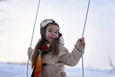 Happy cute preschool girl having fun, playing at winter walk outdoors, winter family lifestyle Stock Photo