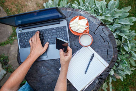 Home office concept, distant working during lockdown. A man, freelancer, working remotely in the farm at countryside, with cheese and ecological milk, online education and job, countryside lifestyle 版權商用圖片