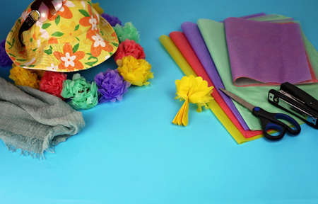 Sunglasses, hat and Hawaiian garland with paper flowers, party decoration, vacation and travel concept, DIY, ready for summer