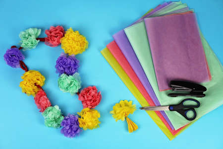 Hawaiian garland with paper flowers, party decoration, vacation and travel concept, DIY