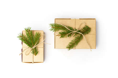 craft boxes with pine tree branches and natural rope isolated on white