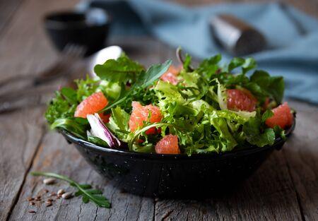 Green light vegetable salad with arugula and grapefruit