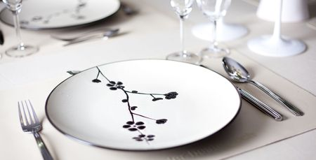 A dinner plate, knife, spoon and fork  photo