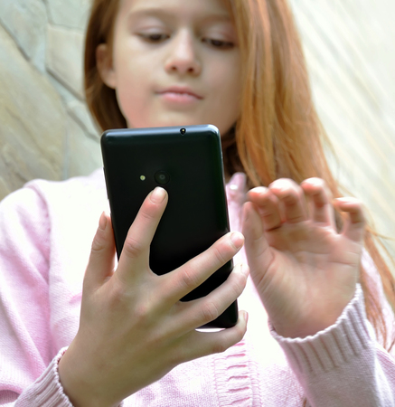 selfy: A girl is taking the selfy with a smartphone