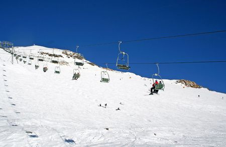 chairlift: chairlift in full sun Stock Photo
