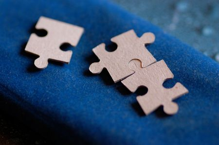 insoluble: puzzle game on a blue velvet cloth Stock Photo