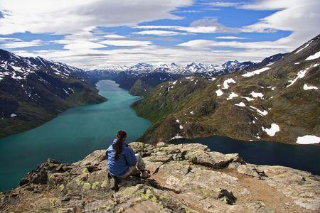 Hiker taking a rest at Bessegen, Norway Stock Photo - 3996561