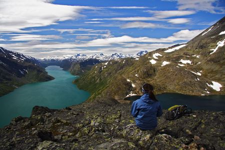Hiker taking a rest at Bessegen, Norway Stock Photo - 3996560