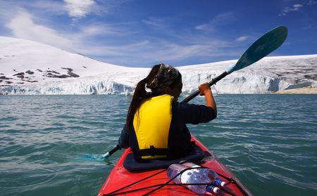 Kayak at glacier lake, Styggevatnet, Jostedalsbreen in Norway. Stock Photo - 3996556