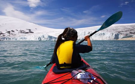 Kayak at glacier lake, Styggevatnet, Jostedalsbreen in Norway. Stock Photo - 3996556