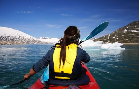 Kayak at glacier lake, Styggevatnet, Jostedalsbreen in Norway. Stock Photo - 3996553