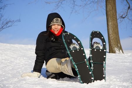 Young woman taking a hiking break with Snow shoes / Rackets in Quebec, Canada Stock Photo - 4103341