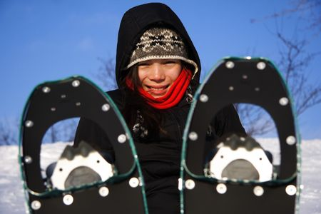 Young woman taking a hiking break with Snow shoes / Rackets in Quebec, Canada Stock Photo - 4103340