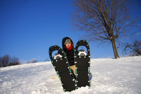snow break: Young woman taking a hiking break with Snow shoes  Rackets in Quebec, Canada