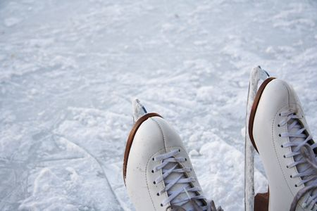 ice rink: closeup of figure skating ice skates with snow oudoors Stock Photo