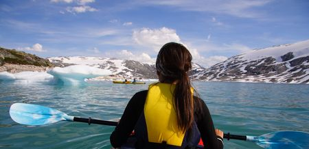 kayaker: Kayak at glacier lake, Styggevatnet, Jostedalsbreen in Norway. Summer.