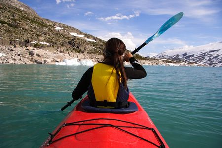 Kayak at glacier lake, Styggevatnet, Jostedalsbreen in Norway. Summer. Stock Photo - 4307300