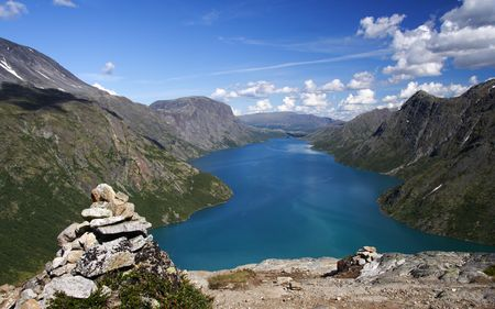 Cairn / Stone pile marking the famous Bessegen hiking trail in Jotunheim National Park, Norway. Gjende Lake. Stock Photo - 4349489